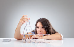 Young woman is making a house of cards 1 Royalty Free Stock Photos