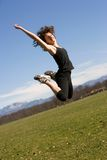 Young woman making a jump Royalty Free Stock Photography