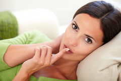 Young woman making a keep quiet gesture Royalty Free Stock Image