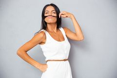 Young woman making mustache Stock Images
