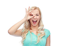 Young woman making ok hand gesture Royalty Free Stock Image