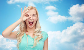 Young woman making ok hand gesture Stock Photography