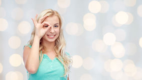Young woman making ok hand gesture Royalty Free Stock Images