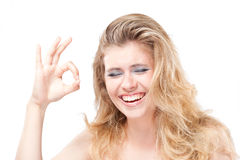 young woman making an ok sign Stock Photos