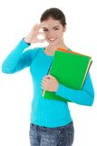 Young woman making ok sign holding notes Royalty Free Stock Photography