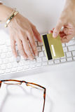 Young woman making payments online while typing on the computer Royalty Free Stock Photo