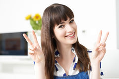 Young Woman Making Peace Gesture With Hands Stock Image
