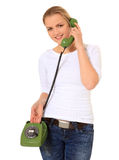 Young woman making a phone call. Attractive young woman making a phone call with retro telephone. All on white background Royalty Free Stock Photography