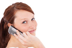 Young woman making phone call. Attractive young woman making phone call. All on white background Royalty Free Stock Photo
