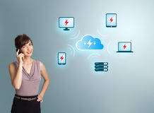 Young woman making phone call with cloud computing network Royalty Free Stock Images
