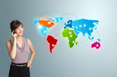 Young woman making phone call with colorful world map Stock Image