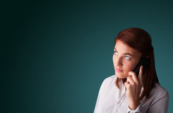 Young woman making phone call with copy space Royalty Free Stock Images