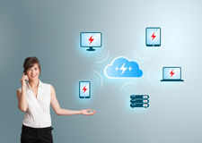 Young woman making phone call and presenting cloud computing net Stock Photo