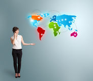 Free Young Woman Making Phone Call With Colorful World Map Stock Images - 51014084