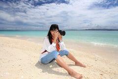 Young woman making photo using slr Royalty Free Stock Photo