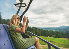 Young woman making photoes on cable car, Poland royalty free stock photo