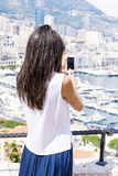 Young woman making photos  at Monte Carlo harbour in Monaco. Azur coast. Stock Photos