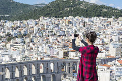 Young woman making pictures of the cityscape in Kavala,Greece Royalty Free Stock Image