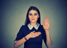 Young woman making a promise Stock Images