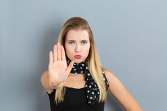 Young woman making a rejection pose. On a gray background Royalty Free Stock Images