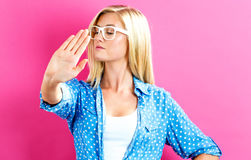 Young woman making a rejection pose. On a pink background Royalty Free Stock Image