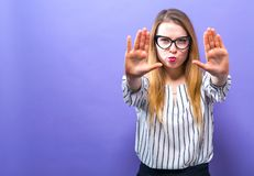 Young woman making a rejection pose. On a solid background Royalty Free Stock Photography
