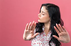 Young woman making a rejection pose. On a solid background stock photos