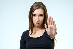 Young woman making rejection pose. On white background Stock Image