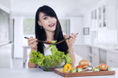 Young woman making salad Stock Image
