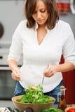 Young woman making salad Royalty Free Stock Photo