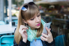 Young woman making self portrait using smartphone Stock Images