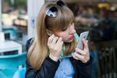 Young woman making self portrait using smartphone Royalty Free Stock Images