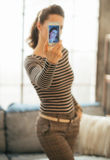 Young woman making selfie in loft apartment Royalty Free Stock Photos