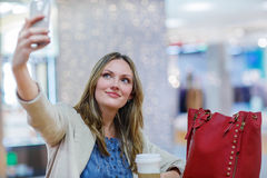Young woman making selfie with mobile phone Royalty Free Stock Images