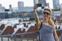 Young woman making selfie photo on the observation deck. Royalty Free Stock Images