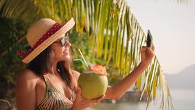 Young Woman Making Selfie Photo Using Mobile Phone on Tropical Paradise Island Beach. 4K, Slowmotion. Phuket, Thailand. Young Woman Making Selfie Photo Using stock footage