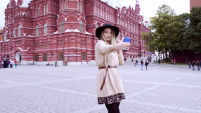 Young woman making selfie at Red Square in Moscow, Russia stock footage