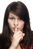 Young woman making sign to keep quiet Stock Photography