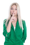 Young woman making silent sign isolated on white. Blonde young woman with her forefinger before mouth stock photos