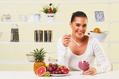Young woman making a smoothie fruit drink health delicious sip weight loss diet Royalty Free Stock Photos