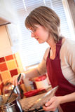 Young Woman Making Soup Royalty Free Stock Photography