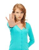 Young woman making stop gesture Stock Photography