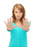 Young woman making stop gesture Royalty Free Stock Image