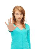 Young woman making stop gesture Royalty Free Stock Photos