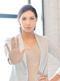 Young woman making stop gesture Stock Image