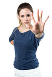 Young woman making stop sign in front of the camera Stock Images