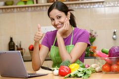 Young woman making thumbs up gesture Stock Images