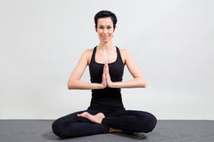 Young woman making yoga Stock Images