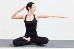 Young woman making yoga Stock Photos