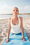 Young woman making yoga exercises outdoors Stock Photo
